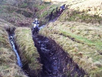 Motor cyclists on lane, Peak District, Derbyshire